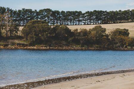 sunny Australian beach in Cremorne, Tasmania looking beautiful and deserted in winter Banco de Imagens