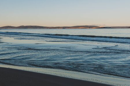 view of the water on a Tasmanian beach in South Hobart at dusk