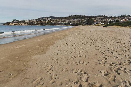 Seven Mile beach in Tasmania, Australia looking deserted n an overcast winter day