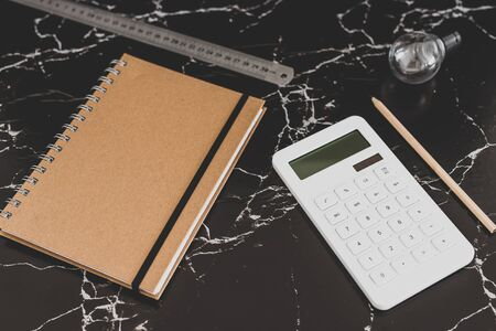back to work concept: desk with mixed stationery items and notebook for future projects or tasks Stock Photo