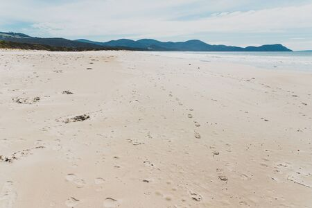 sunny pristine and deserted beach overlooking the South Pacific Ocean in Marion Bay along the East Coast of Tasmania Australia Banco de Imagens