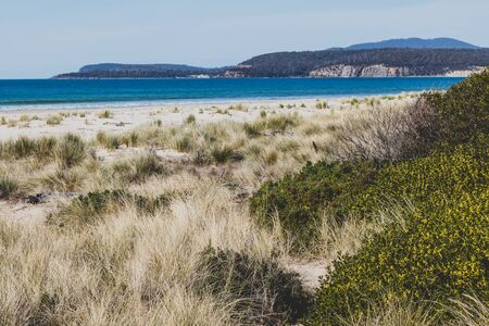 sunny pristine and deserted beach overlooking the South Pacific Ocean in Marion Bay along the East Coast of Tasmania Australia Stock Photo