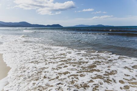 sunny pristine and deserted beach overlooking the South Pacific Ocean in Marion Bay along the East Coast of Tasmania Australia