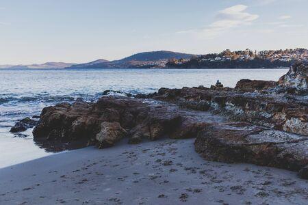 HOBART, AUSTRALIA - September 19th, 2019: Tasmanian beach landscape view in Hobart shot at dusk with soft light