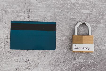 buyer protection and sensitive data online, credit card with security lock on light concrete background