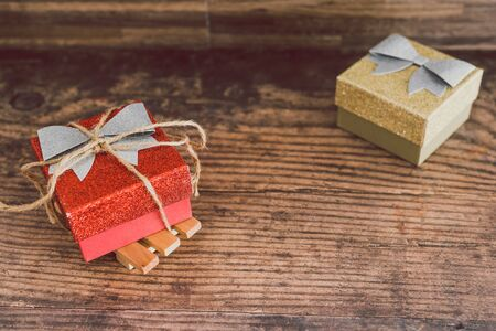 Christmas present box with bow and glitters, concept of gift giving and seasonal holiday shopping
