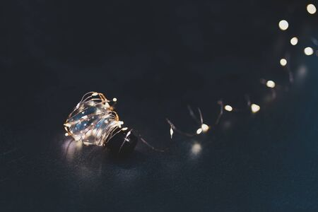 concept of inventiveness and brilliant creativity, idea lightbulb wrapped up in string lights shining all around it and with bokeh 스톡 콘텐츠