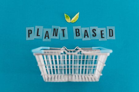 environmentally conscious consumer choices conceptual illustration, shopping basket with leaves and Plant-based text metaphor of vegan and eco-friendly products and diet