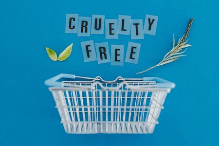 conscious consumer choices for animal rights conceptual illustration, shopping basket with leaves and Cruelty free text metaphor of vegan and eco-friendly products and diet Standard-Bild