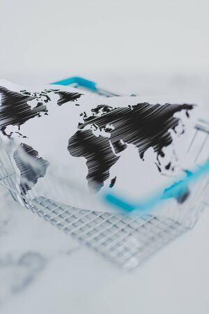 global business or worldwide delivery conceptual still-life, shopping basket with world map inside of it