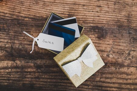 global marketing and promotional offers conceptual still-life, present box with payment or gift cards inside