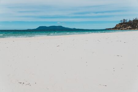 Spring beach in Tasmania, Australia looking pristine and deserted with white sand and turquoise water of the South Pacifc Ocean