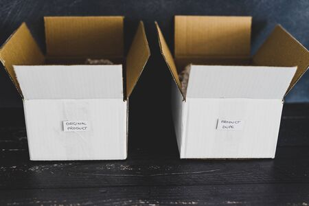 original product vs dupe imitation label inside delivery parcel boxes from online purchases, concept of competition and knock-off items