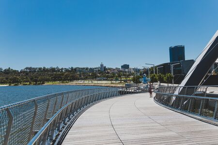 PERTH, WESTERN AUSTRALIA - December 24th, 2019: Elizabeth Quay's pedestrian bridge over the bay and the Swan River on a sunny day Editorial