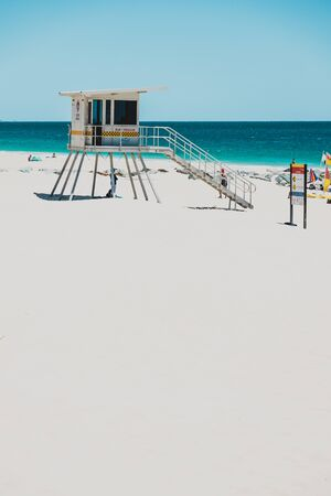PERTH, AUSTRALIA - January 5th, 2020: view of City Beach near Perth with white sand and turquoise waters of the Indian Ocean with tourists and locals enjoying the sunshine