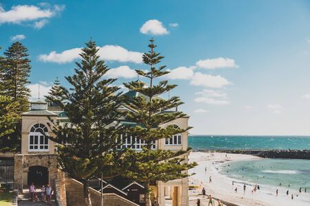 PERTH, AUSTRALIA - December 27th, 2019: view of Cottesloe beach, one of the most popular beaches near Perth in Western Australia on a sunny summer day