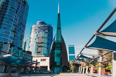 PERTH, AUSTRALIA - December 28th, 2019: the Bell Tower, one of the main landmark of the City of Perth in the CBD shot at dusk with serene clear blue sky