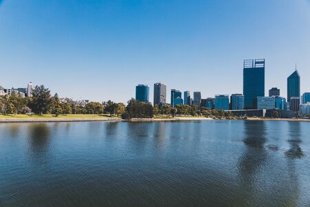 PERTH, AUSTRALIA - January 6th, 2020: view of Elizabeth Quay in Perth from the water, a newly built harbour area with modern architecture and beautiful views on the Swan River