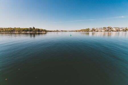 PERTH, WESTERN AUSTRALIA - January 6th, 2020: view of the Swan River and surrounding coastline from the water on a sunny summer day
