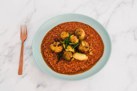 healthy plant-based recipes, vegan bolognaise sauce with textured vegetable protein and oven baked potatoes Stock Photo