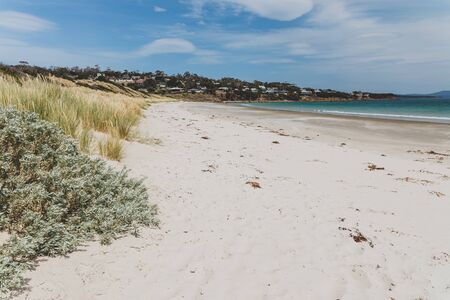 PRIMROSE SANDS, TASMANIA - January 22nd, 2020: the pristine beach of Primrose Sands and surrounding coastline on a warm summer day with not many people