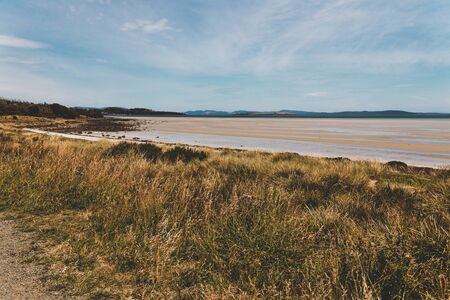 landscape of Dunalley Beach in the Tasman Peninsula in Tasmania, Australia on a summer day with low tide Stock Photo