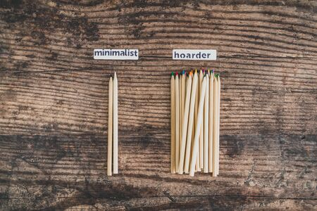 minimalist vs hoarder lifestyle conceptual still-life, 2 tidy pencils vs messy group of all colors Stock Photo - 140019166