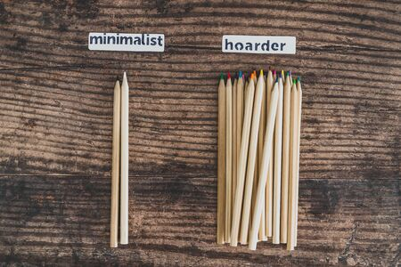 minimalist vs hoarder lifestyle conceptual still-life, 2 tidy pencils vs messy group of all colors