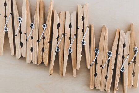 group of wooden peg to hang the washing, concept of sustainable living and alternative to plastic