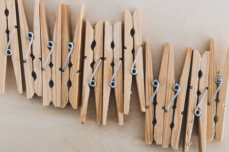 group of wooden peg to hang the washing, concept of sustainable living and alternative to plastic Stock Photo - 140078030