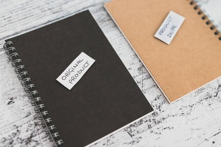 concept of product imitation, Original Product vs Product Dupelabels on similar notebooks in different colors