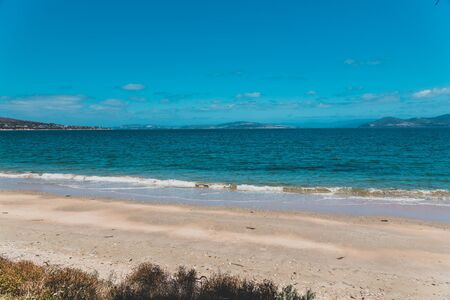 landscape in South Arm Beach near Opossum Bay on a sunny summer day with nobody on the beach with deep blue water and clear skies enhancing the beautiful coastline and shores Stock Photo