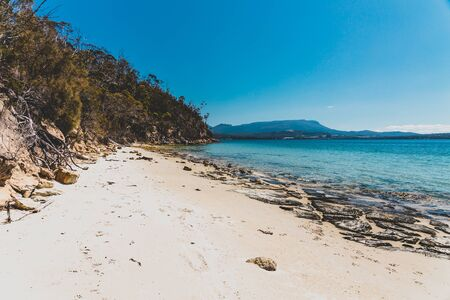 wild Tasmanian landscape and pristine turquoise water of the Derwent River as seen from Legacy Beach near Coningham beach south of Hobart