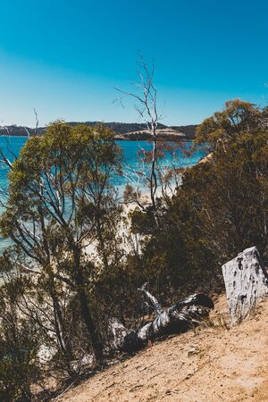 wild Tasmanian landscape and pristine turquoise water of the Derwent River as seen from Legacy Beach walking track near Coningham beach south of Hobart Stock Photo