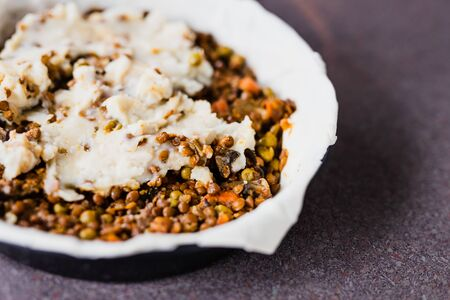 healthy plant-based food recipes, vegan shepherd's pie with lentils and mash potatoes in the making Stock Photo - 142510373