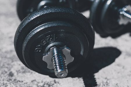 keeping fit and exercising outdoor or at home, set of heavy dumbbells on concrete path in a backyard Stock Photo - 142539791