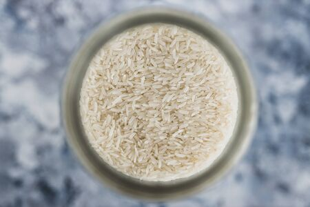 healthy non-perishable food ingredients for vegan pantry, glass jars with oats flour and rice