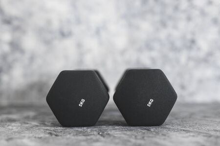 sport and fitness gear, set of black dumbbells on concrete shot at shallow depth of field 版權商用圖片