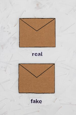 trust-wrothy vs fake emails or online scams concept, email envelop icons with real vs fake labels on them