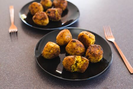 healthy plant-based food recipes concept, deep fried risotto arancini balls with vegan cheese filling Stock fotó