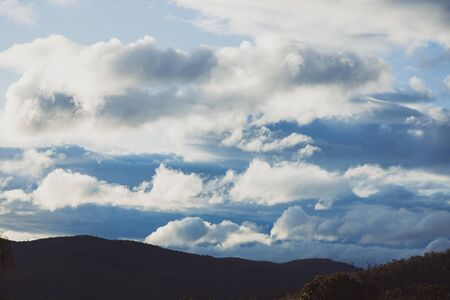 beautiful clouds over the mountains in Tasmania shot near Kunanyi also known as Mount Wellington Stock Photo