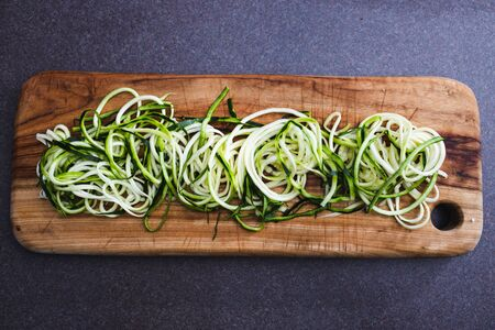 simple food ingredients concept, zucchini noodles on wooden cutting board Stock Photo - 148862568