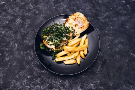 healthy plant-based food recipes concept, vegan burger with charred kale pickles dairy-free cheese and chips Stock Photo - 148862200