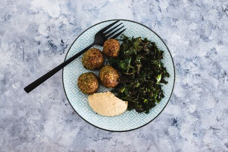 healthy plant-based food recipes concept, vegan chickpea falafels with kale chips and hummus Stock Photo - 148961383