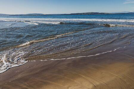 beautiful pristine Tasmanina beach with serene blue sky on a winter morning Stock Photo - 148961898