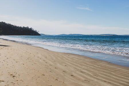 beautiful pristine Tasmanina beach with serene blue sky on a winter morning Stock Photo - 148961658