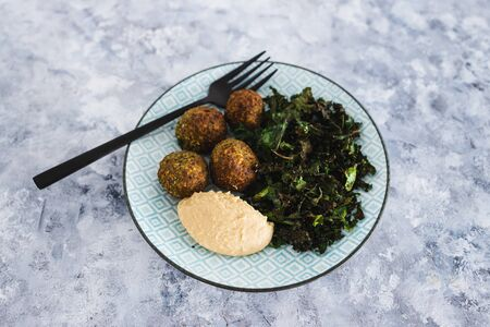 healthy plant-based food recipes concept, vegan chickpea falafels with kale chips and hummus Stock Photo - 148961824