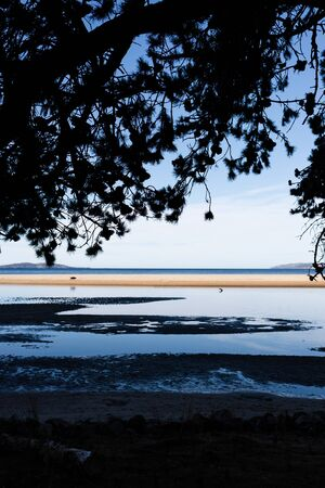 beautiful pristine Tasmanina beach with water inlets and with serene blue sky on a winter morning Stock Photo - 148961817