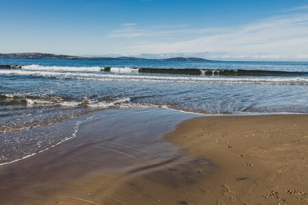 beautiful pristine Tasmanina beach with serene blue sky on a winter morning Stock Photo - 148962280