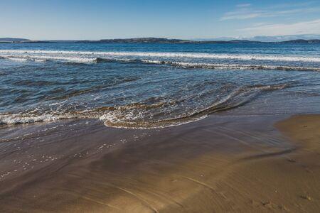 beautiful pristine Tasmanina beach with serene blue sky on a winter morning Stock Photo - 148961939